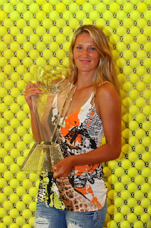 Picture of Azarenka posing off court with Miamia trophy