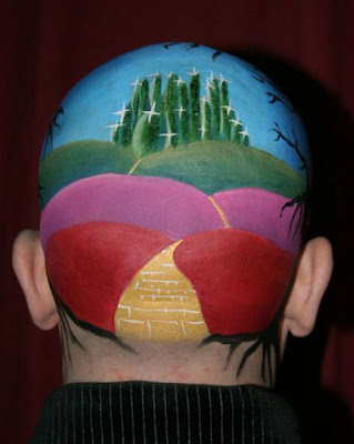 Bald Artist Uses His Head as a Canvas Seen On www.coolpicturegallery.net