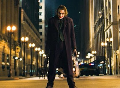 The Joker wonders, 'How does Batman get all those wonderful toys when the economy's in the crapper?'