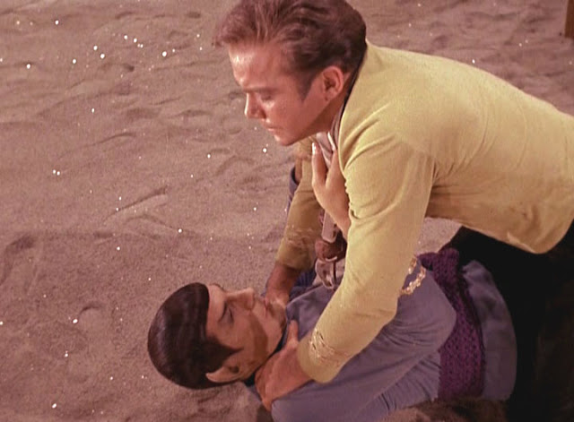 The heat from those soundstage lights must be killing Kirk.