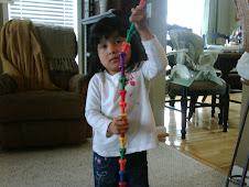 Sarah Beth building a peg tower!
