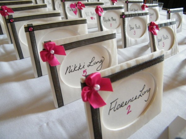 The pink ribbons on the name cards which were fabriccovered picture frames