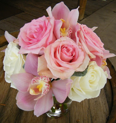 This bridal bouquet consisted of white Cymbidium Orchids pink miniCalla