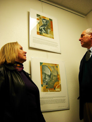 Bob Barancik and Mary Ellen Bitner, Art Curator, look at portraits of Jan Karski and Andrei Sakharov