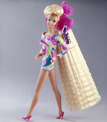 were Totally Hair Barbies. I had this one, but with brown hair (Midge?):