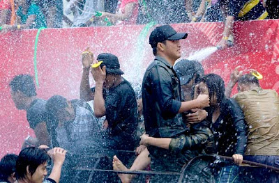 Young people are sprayed with water during the annual 'water festival' in Yangon, Myanmar.