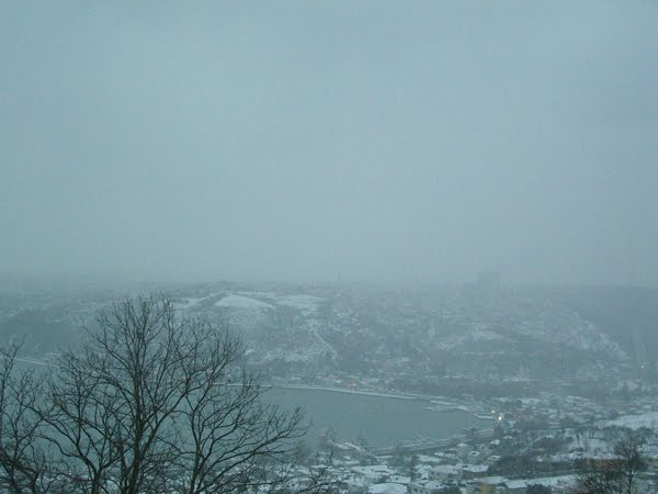 An Istanbul bay and hills in a snowstorm.