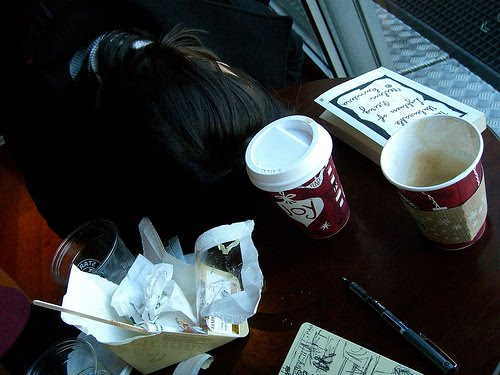 My sister Natasha catching some sleep in Schiphol's Starbucks.
