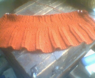red-orange provincial waistcoat showing about 11 inches of work