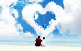 Lovers sitting on Beach Heart Shaped Clouds HD Valentines Day Wallpaper