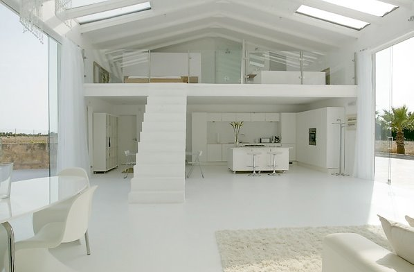 Arquitectura de casas escalera minimalista en un loft de for Estilo de casa minimalista