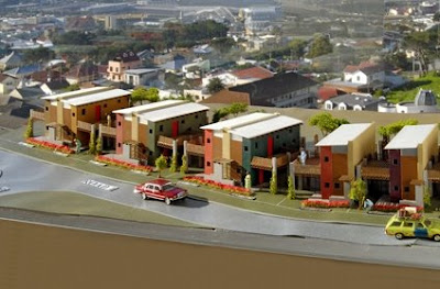 Maqueta del barrio de casas hechas con bolsas de arena
