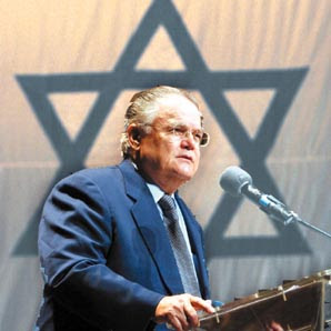 Hagee before Israeli flag