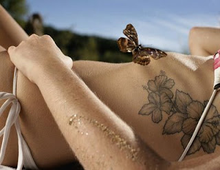 flower tattoo on a woman body side wearing a bikini