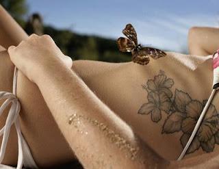 flower tattoo on a woman body side wearing a bikini