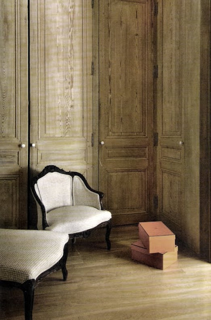 Tall white oak closet doors with upholstered chair and ottoman, from Cote Maison, edited by lb for linenandlavender.net