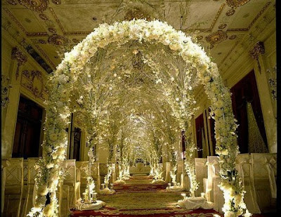 Instead make an arch of decorative fabric flowers vines or for a really