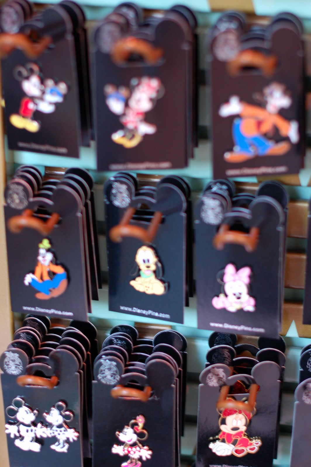 halloween time gifts are offered in disneyland resort shops gifts include jack o lantern mouse ears and collectable pins depicting mickey mouse and his