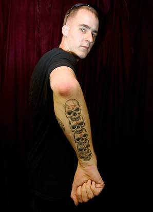 Still more of Upper Left Arm by Tattoo Tom tribal upper arm tattoo.