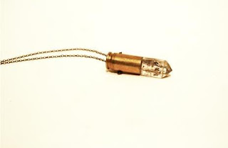 pendant made of a crystal and a bullet casing