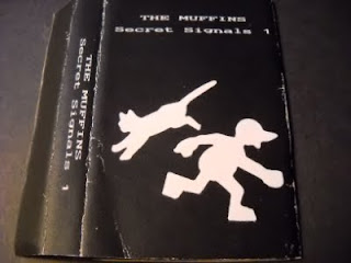 Cover Album of THE MUFFINS-SECRET SIGNALS 1, TAPE, 1989 (RECORDED: 1974-1978), USA