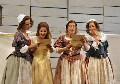 (L to R) Kelley O'Connor (Meg Page), Laura Giordano (Nannetta), Claire Rutter (Alice Ford), and Nancy Maultsby (Quickly) in Act I, scene 2 of Falstaff, costumes by Clare Mitchell, Santa Fe Opera, 2008 (photo © Ken Howard)