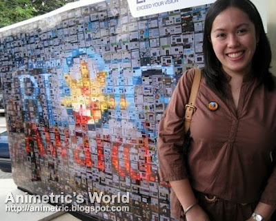 Me standing in front of the 2009 Philippine Blog Awards' photomosaic