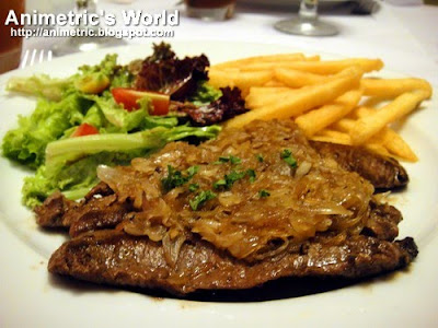 Seared US Beef Flank with Roasted Shallots Sauce, Fries, and Salad at Je Suis Gourmand