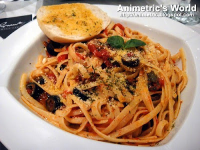 Linguini with Putanesca Sauce and Spicy Tuyo at Romulo Cafe