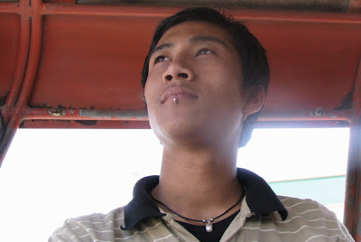 >a burmese young man with pierced lip