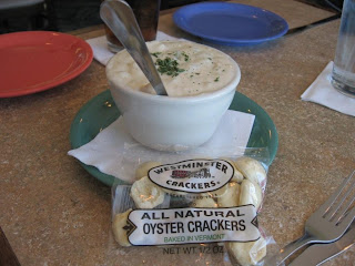 Click to enlarge - Clam chowder with a bag of oyster crackers.