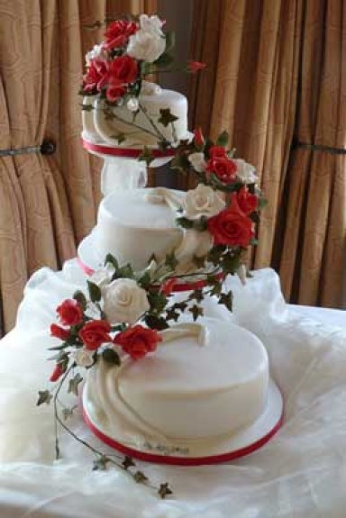 3 Tier Cascade Roses Three tier white cake with cascade red and white roses