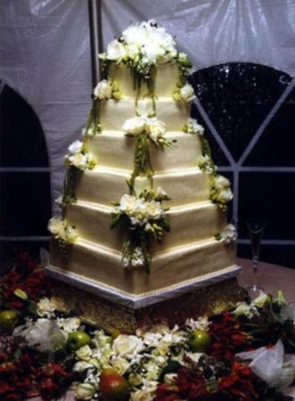 6tier wedding cake made up of white cake with a white chocolateraspberry