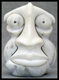 sculpture sur pierre portrait masculin stylisé art humour