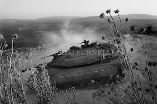 Israeli tanks crossing the border with Lebanon during the Israel Hezbollah war, Aug 2006. Copyright &#169; Greg Funnell 2007. All rights reserved.
