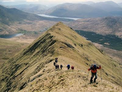 Hill walkers climbing Mweelrea in county Mayo