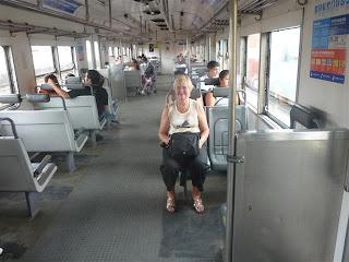 Carla in de trein naar 'Le Tigre'.