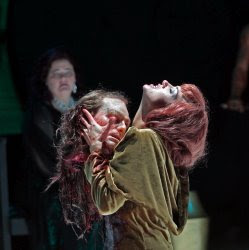 Kelly Kaduce in the title role of Opera Theatre's 2009 production of Richard Strauss SALOME, shown with the head of Jokanaan, with Maria Zifchak as Herodias Copyright: Ken Howard