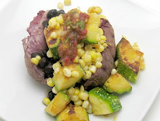 corn sauteed with zucchini and heirloom tomato salsa atop a pink potato