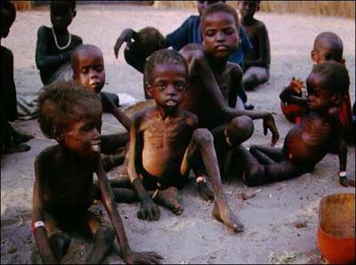 Darfur children wait for help