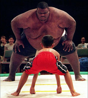 Crazy picture of a boy against Sumo