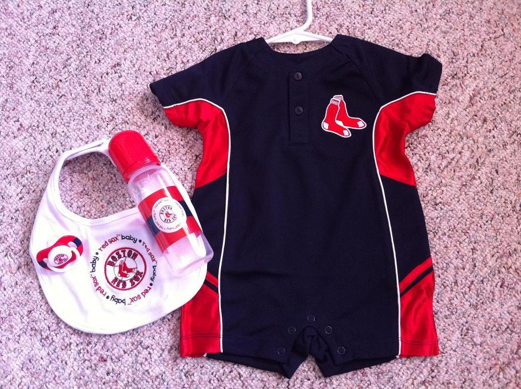... pulled out an adorable Boston Red Sox onesie, bib, pacifier, and bottle!