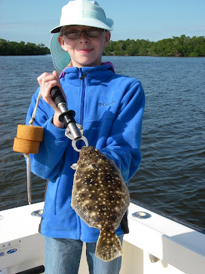 kid with flounder