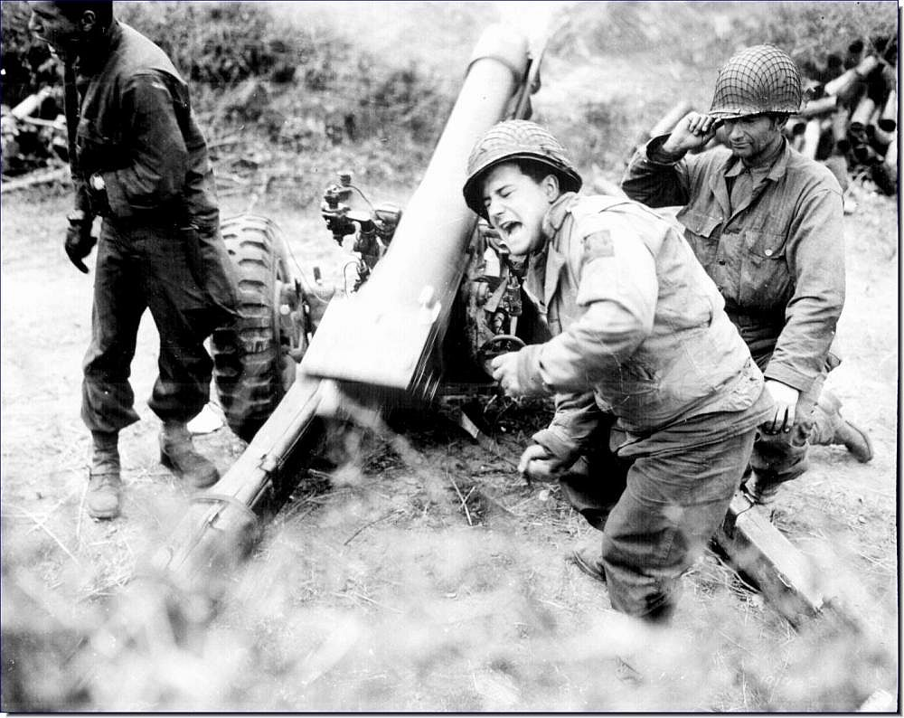American howitzer pounds retreating germans near carentan france