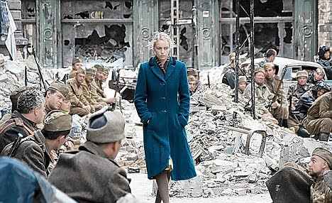 German girl walks past Soviet troops in a scene from A Woman In ...