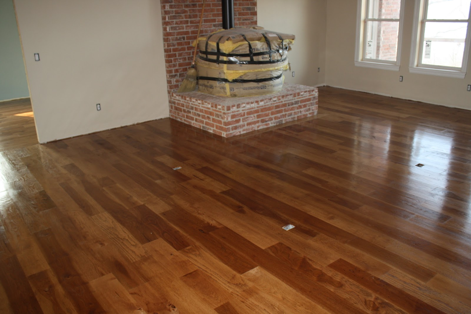 A View Of The Family Room With Semi Finished Floors Darker Stained Wood Is Heart Cut Material And Lighter More Traditional Hickory