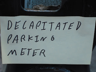 decapitated parking meter