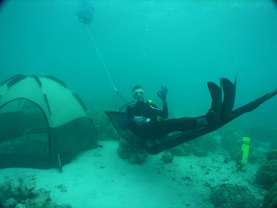 No submerged tropical campsite is complete without an underwater hammock