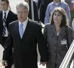 Mike Nifong and his wife Cy Gurney, right, arrive for his bar hearing