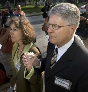 Nifong walks into court with his wife, Cy Gurney, Sat. morning for his disciplinary hearing